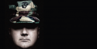 Image of a shadowed face wearing a camouflage hat