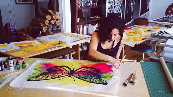 Image of Favianna Rodriguez creating art work.